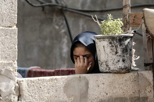 Woman mourning on September 27, 2020 [MAHMUD HAMS/AFP via Getty Images]