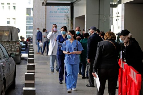 Medical staff are pictured outside AUBMC (American University of Beirut Medical Centre) in the Lebanese capital Beirut on March 17, 2021 [ANWAR AMRO/AFP via Getty Images]