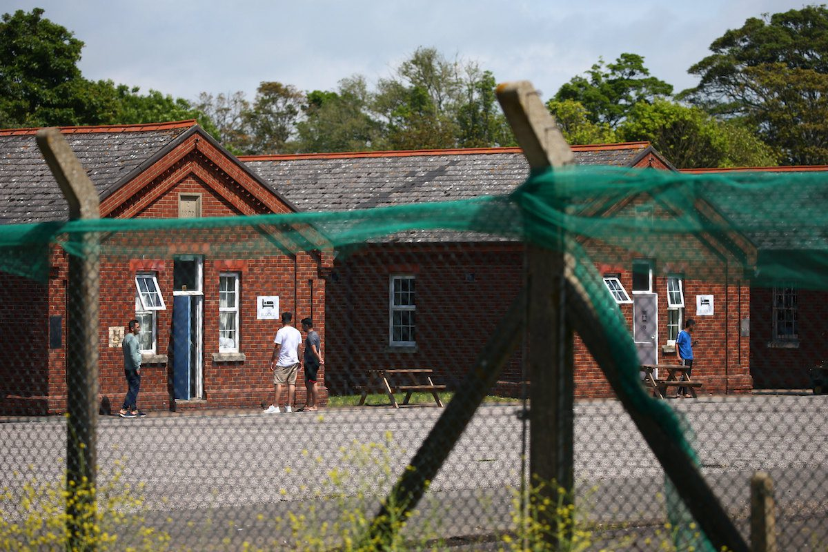 Asylum seekers inside Napier Barracks on June 20, 2021 in Folkestone, England. [Hollie Adams/Getty Images]
