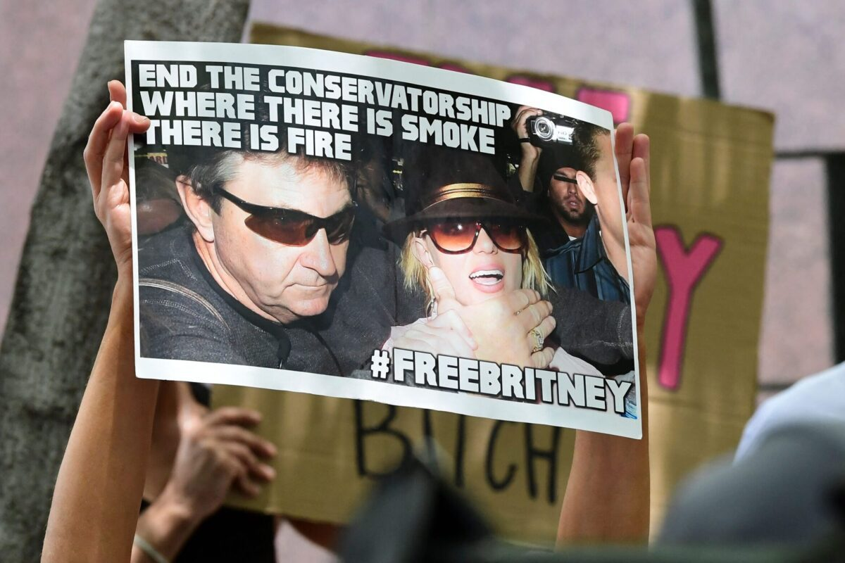 Fans and supporters of Britney Spears hold placards as they gather outside the County Courthouse in Los Angeles, California on June 23, 2021 [FREDERIC J. BROWN/AFP via Getty Images]