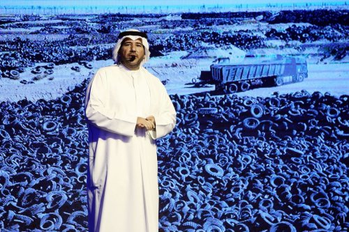 Director general and chairman of the board of Kuwait's environment public authority (EPA) Sheikh Abdullah al-Ahmad al-Sabah speaks during a ceremony in Kuwait City on 29 August 2021, announcing the total transfer of hundreds of tons of discarded tyres from the Rahiya area, one of the world's biggest tyre dumps, 35 kilometers west of the capital, to the Salmi border area, ahead of recycling. - Kuwait hopes to transform what was once a landfill of ever-growing mounds of tyres to a sparkling new residential city. [YASSER AL-ZAYYAT/AFP via Getty Images]
