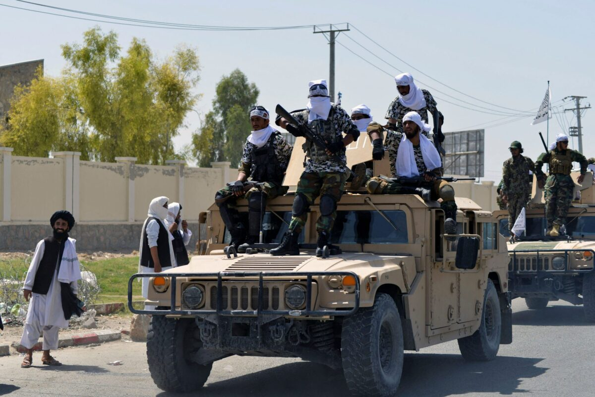 Taliban fighters atop Humvee vehicles parade along a road to celebrate after the US pulled all its troops out of Afghanistan, in Kandahar on September 1, 2021 following the Talibans military takeover of the country. (Photo by JAVED TANVEER / AFP) (Photo by JAVED TANVEER/AFP via Getty Images)