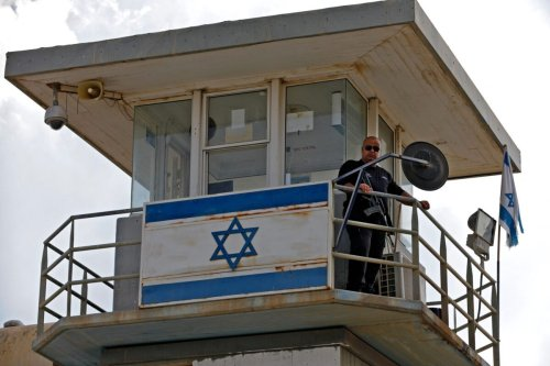 A police officer keeps watch from an observation tower at the Gilboa Prison in northern Israel on September 6, 2021 [JALAA MAREY/AFP via Getty Images]