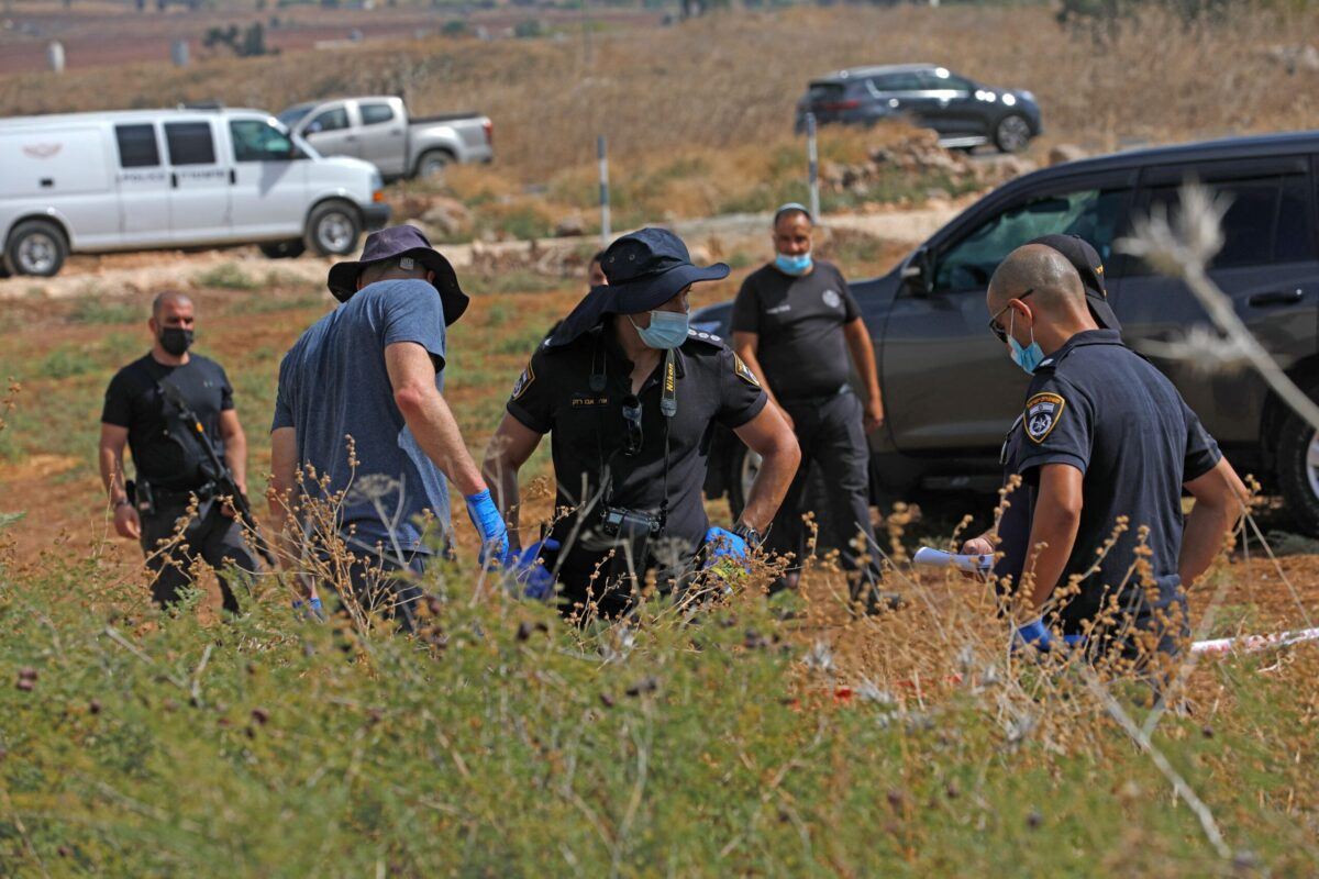 Israeli security personnel search for evidence outside the Gilboa Prison in northern Israel after six Palestinians broke out, on September 6, 2021 [JALAA MAREY/AFP via Getty Images]
