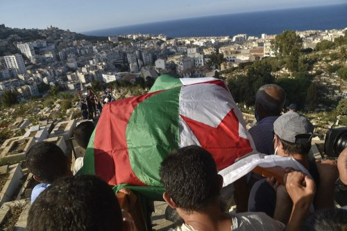 Algerians carry the coffin of former military leader of Algeria's FLN (National Liberation Front) networks of the autonomous zone of Algiers Yacef Saadi, during his funeral at the El Kettar cemetery in the capital Algiers, on 11 September 2021. [RYAD KRAMDI/AFP via Getty Images]