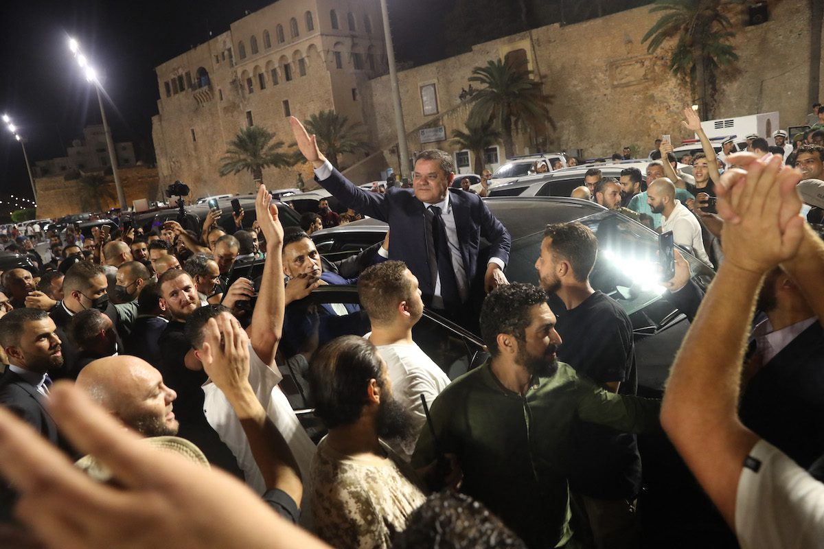 Libya's interim Prime Minister Abdulhamid Dbeibah greets a crowd in Tripoli's Martyrs' Square on 21 September 2021. [MAHMUD TURKIA/AFP via Getty Images]