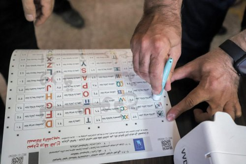Officials of Iraq's electoral commission undergo a polling day simulation to test run its systems ahead of the upcoming parliamentary elections on September 22, 2021 [SHWAN MOHAMMED/AFP via Getty Images]