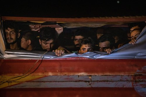 Afghan migrants look out from the top of a smuggler's truck after it was seized by Jandarma officers during a roadside raid on July 10, 2021 in Van, Turkey [Chris McGrath/Getty Images]