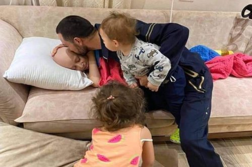 Palestinian father Hijazi Qawasmeh kissing his 11-year-old son who is battling cancer,