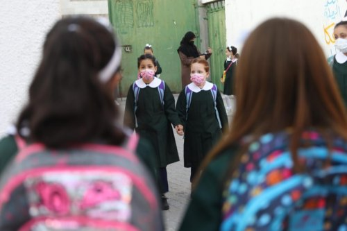 Pupils in Gaza on the first day of the new academic year [Mohammed Asad/Middle East Monitor]
