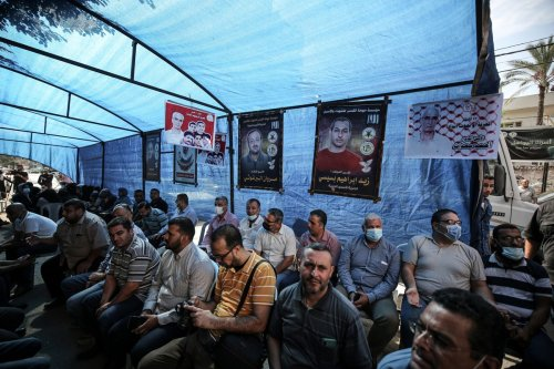 Gazans stage a demonstration in support of Palestinian prisoners in Israeli jails in Gaza City, Gaza on October 14, 2021 [Ali Jadallah - Anadolu Agency]