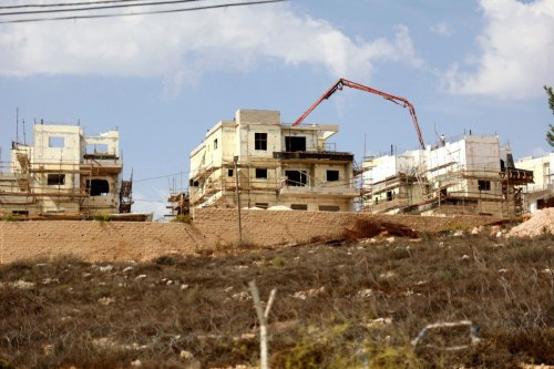 Construction in an Israeli settlement, south of Nablus in the occupied West Bank on 13 October 2021 [JAAFAR ASHTIYEH/AFP/Getty Images]