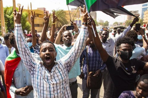 Thousands of Sudanese protest demanding 'the protection of the revolution, the completion of its tasks and the realisation of its demands' in Khartoum, Sudan on 21 October 2021 [Mahmoud Hjaj/Anadolu Age
