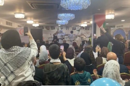 Palestinians come together during an event hosted by Palestinian Forum in Britain in London, UK, 25 October 2021