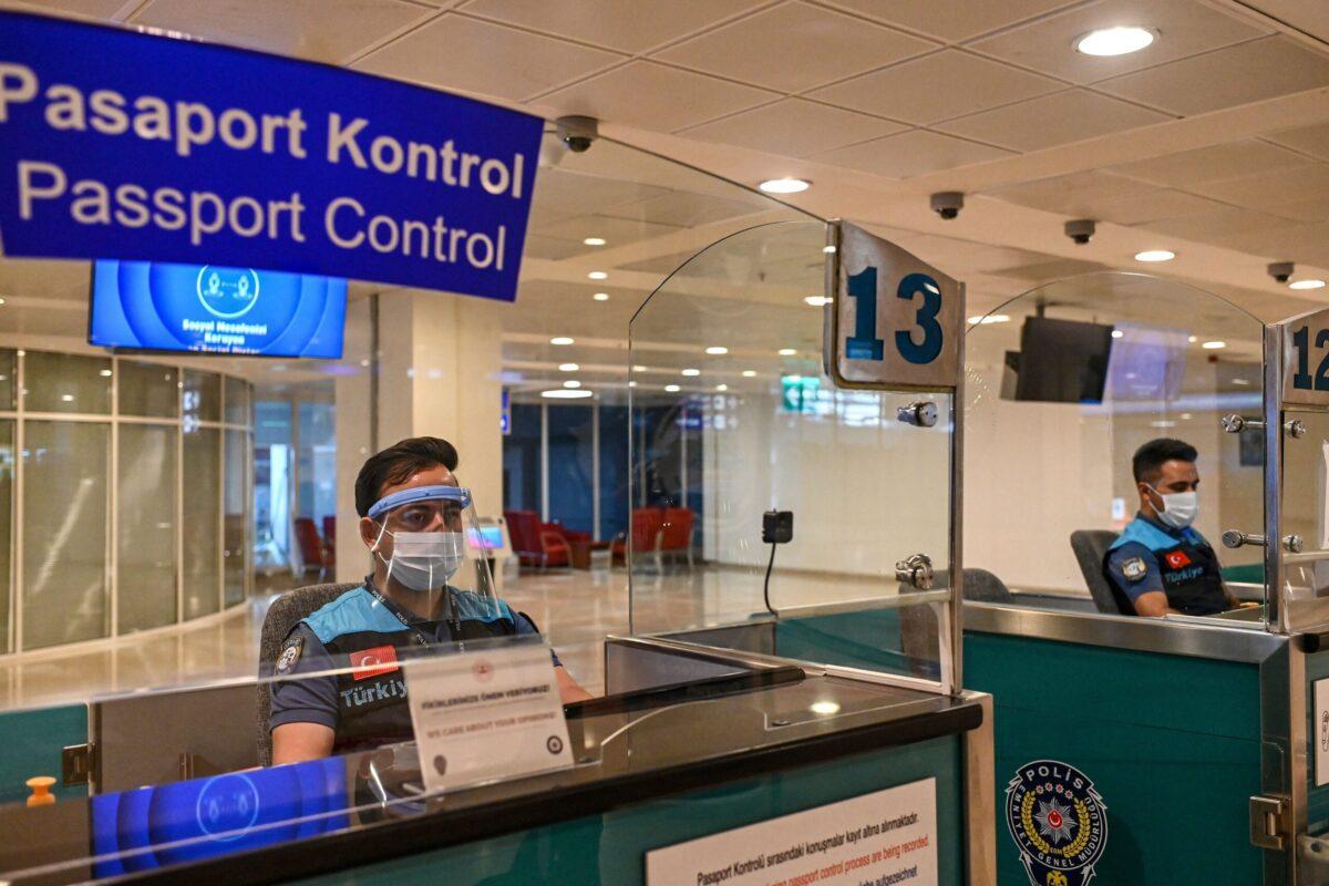 Turkish police at the passport control on June 19, 2020 at Antalya International airport in Antalya [OZAN KOSE/AFP via Getty Images]