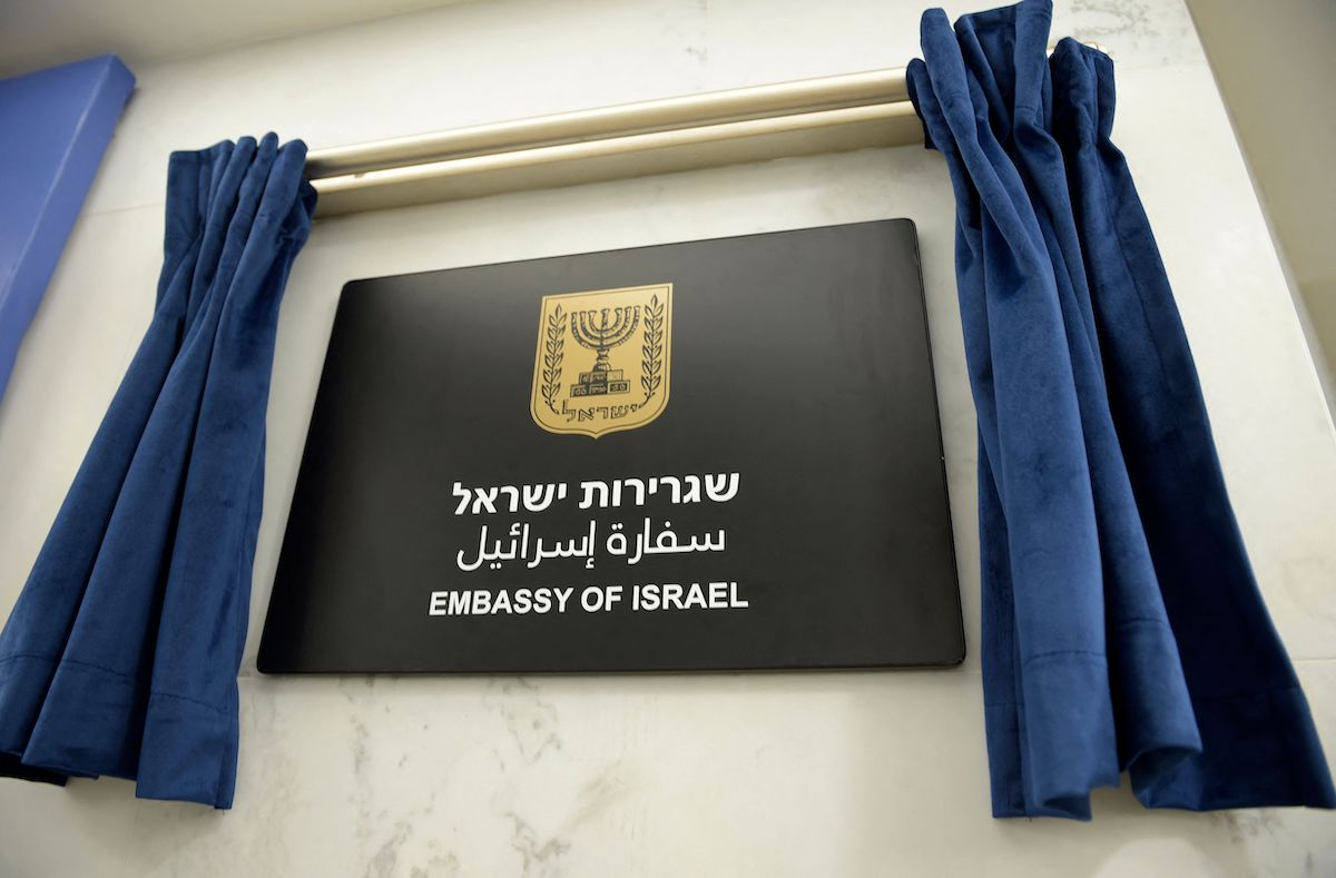 This picture shows the plaque identifying the newly opened Israeli embassy in the Bahraini capital Manama, on 30 September 2021. [MAZEN MAHDI/AFP via Getty Images]
