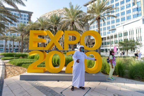 Visitors at the Expo 2020 sculpture during the opening day of the Expo 2020 exhibition in Dubai, United Arab Emirates, on Friday, October 1, 2021 [Christopher Pike/Bloomberg via Getty Images]
