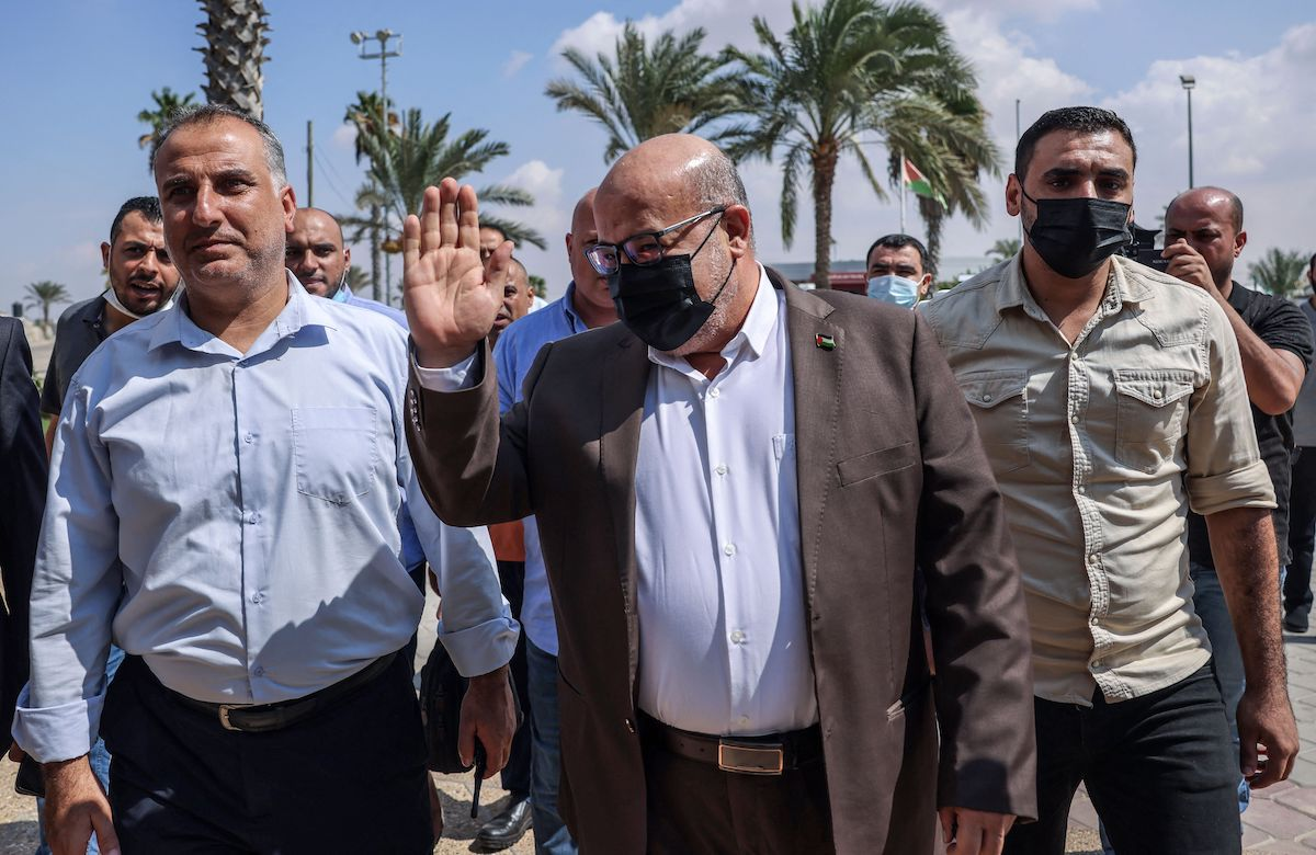 Palestinian official Issam al-Daalis (C) from Hamas' political bureau stands outside the VIP hall at the Rafah border crossing with Egypt in the southern Gaza Strip on 3 October 2021, as a delegation from Gaza travels to Egypt for talks. [SAID KHATIB/AFP via Getty Images]