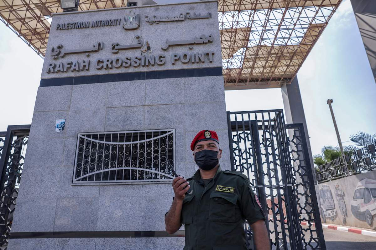 A Palestinian security officer stands guard at the Rafah border crossing with Egypt in the southern Gaza Strip on 3 October 2021, as a delegation from Gaza's Hamas rulers travels to Egypt for talks. [SAID KHATIB/AFP via Getty Images]