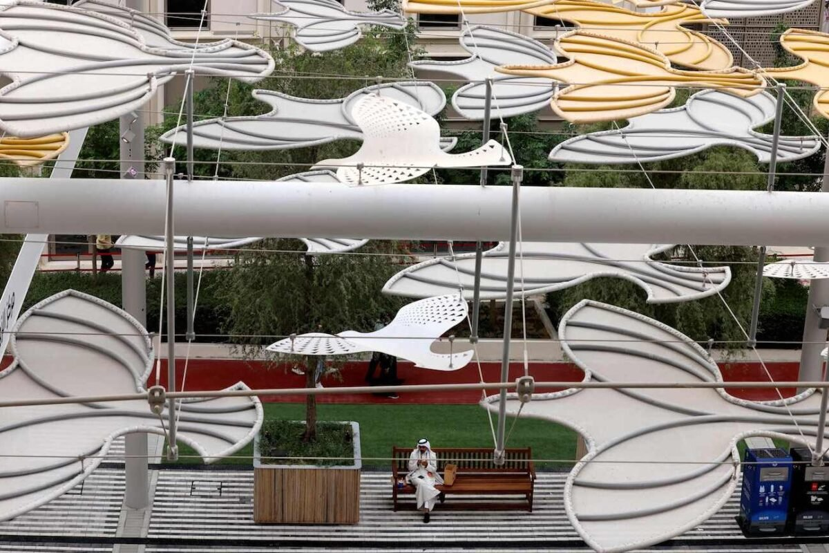 An Emirati sits at UAE's Falcon Pavilion of Expo 2020 in Dubai on October 4, 2021. [KARIM SAHIB/AFP via Getty Images]