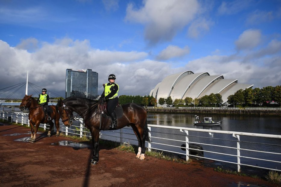 Police Scotland mounted officers patrol near the SSE Hydro venue in Glasgow on October 4, 2021 as the city prepares to host the COP26 UN Climate Summit in November. [ANDY BUCHANAN/AFP via Getty Images]