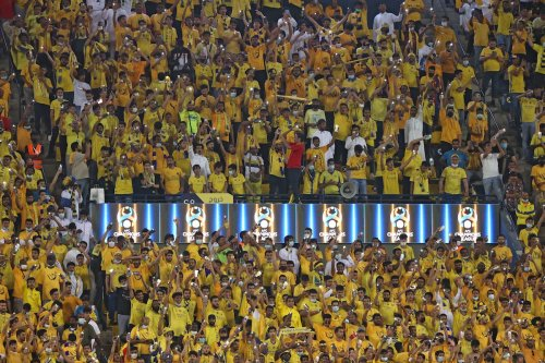 Nassr's fans cheer during the AFC Champions League quarterfinal football match between UAE's Al-Wahda and KSA's Al-Nassr on 16 October 2021, at the Mrsool Park Stadium in Riyadh. [FAYEZ NURELDINE/AFP via Getty Images]