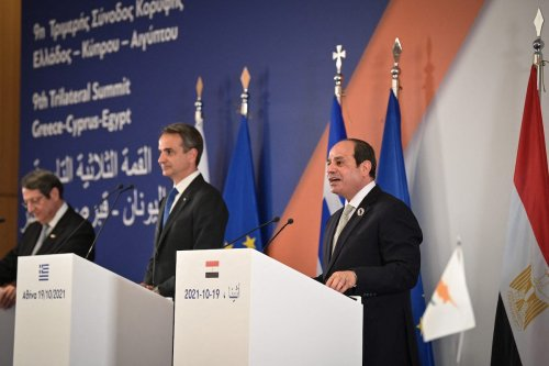 Egypt's President Abdel Fattah El-Sisi (R) speaks alongside Greece's Prime Minister Kyriakos Mitsotakis (L) and Cypriot President Nicos Anastasiades (C) after their trilateral meeting in Athens on 19 October 2021. [ARIS MESSINIS/AFP via Getty Images]