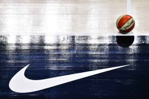 A detail of a basketball on the court near the Nike logo on August 31, 2020 [Julio Aguilar/Getty Images]