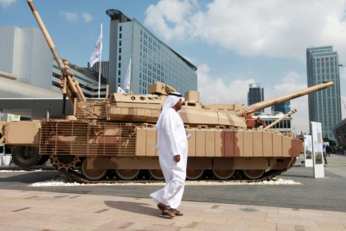 An Arab visitor walks past a battle tank displayed outside the International Defence Exhibition (IDEX) in Abu Dhabi, United Arab Emirates, on Monday, Feb. 23, 2015 [Gabriela Maj/Bloomberg via Getty Images]