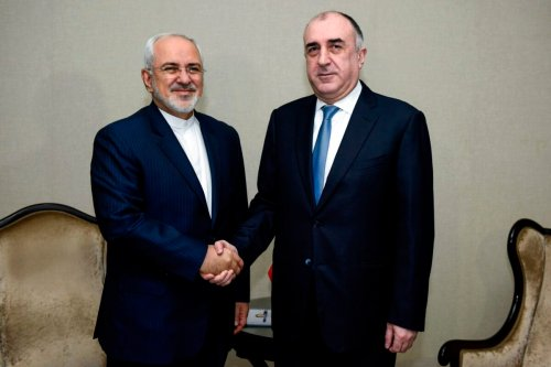 Azerbaijan's Foreign Minister Elmar Mammadyarov (R) meets with his Iranian counterpart Mohammad Javad Zarif in Baku on December 20, 2017 [TOFIK BABAYEV/AFP via Getty Images]