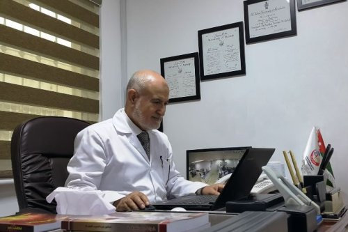 Physician, scientist, writer and Professor Abdul Hamid Al-Qudah in his office [Family file]