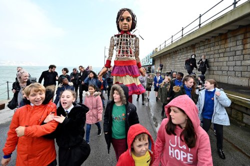 Little Amal takes her first steps in Folkestone as first leg of the UK tour