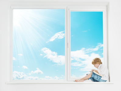 Window sunshine sky. Child on windowsill reading book.