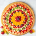 Fruit Pizza topped with strawberries, blueberries, kiwi, mandarin oranges, raspberry