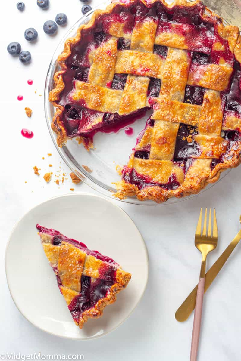 Making blueberry pie from scratch is much easier then you might think! This homemade blueberry pie is bursting with fresh juicy blueberries and tastes amazing alone or with some vanilla ice cream on top.