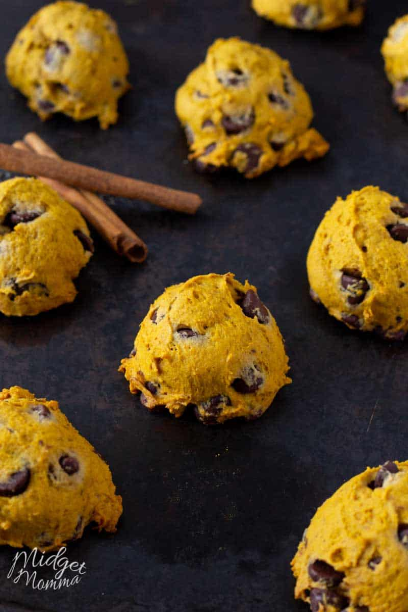 Soft pumpkin cookies with chocolate chips on a baking sheet