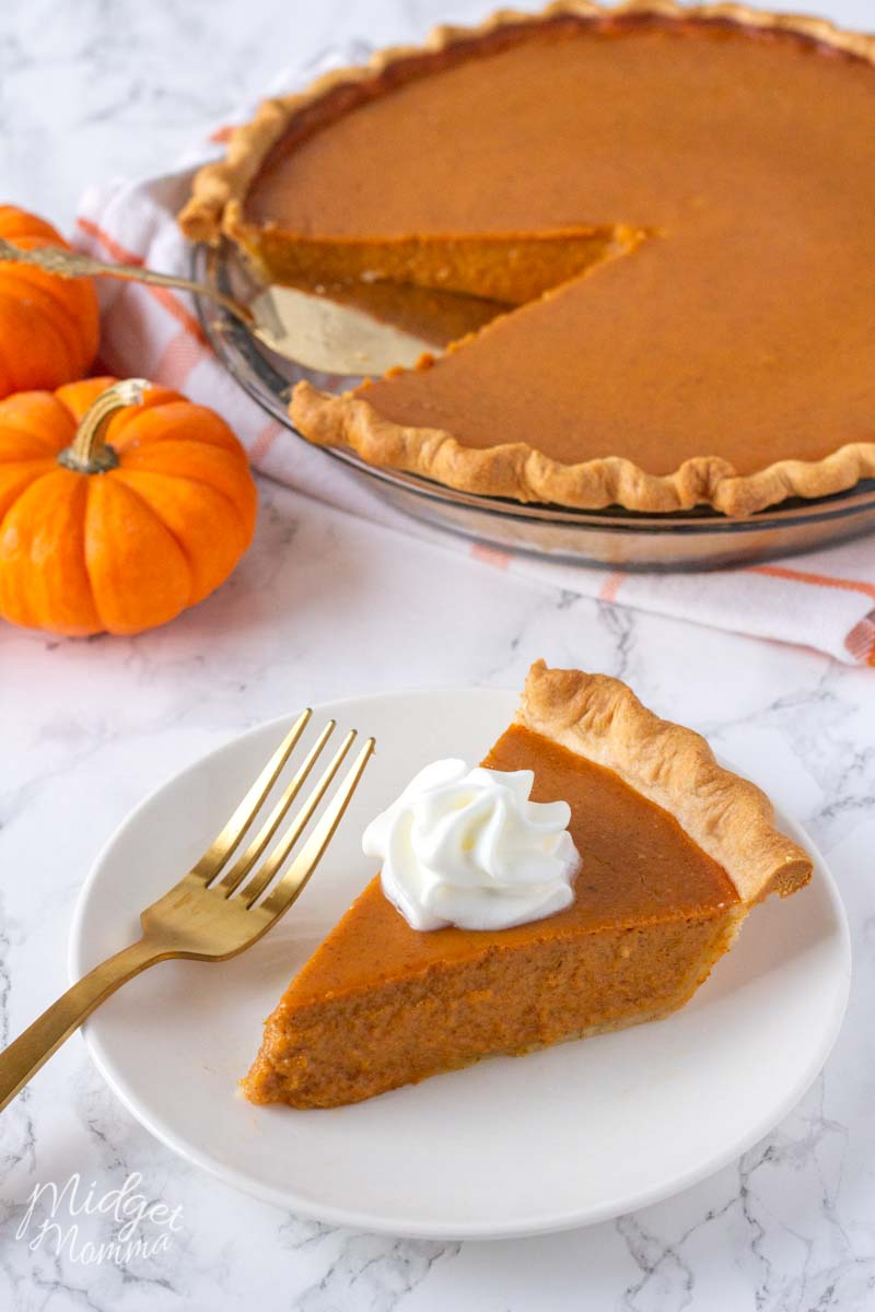pumpkin pie made with fresh pumpkin on a plate topped with whipped cream