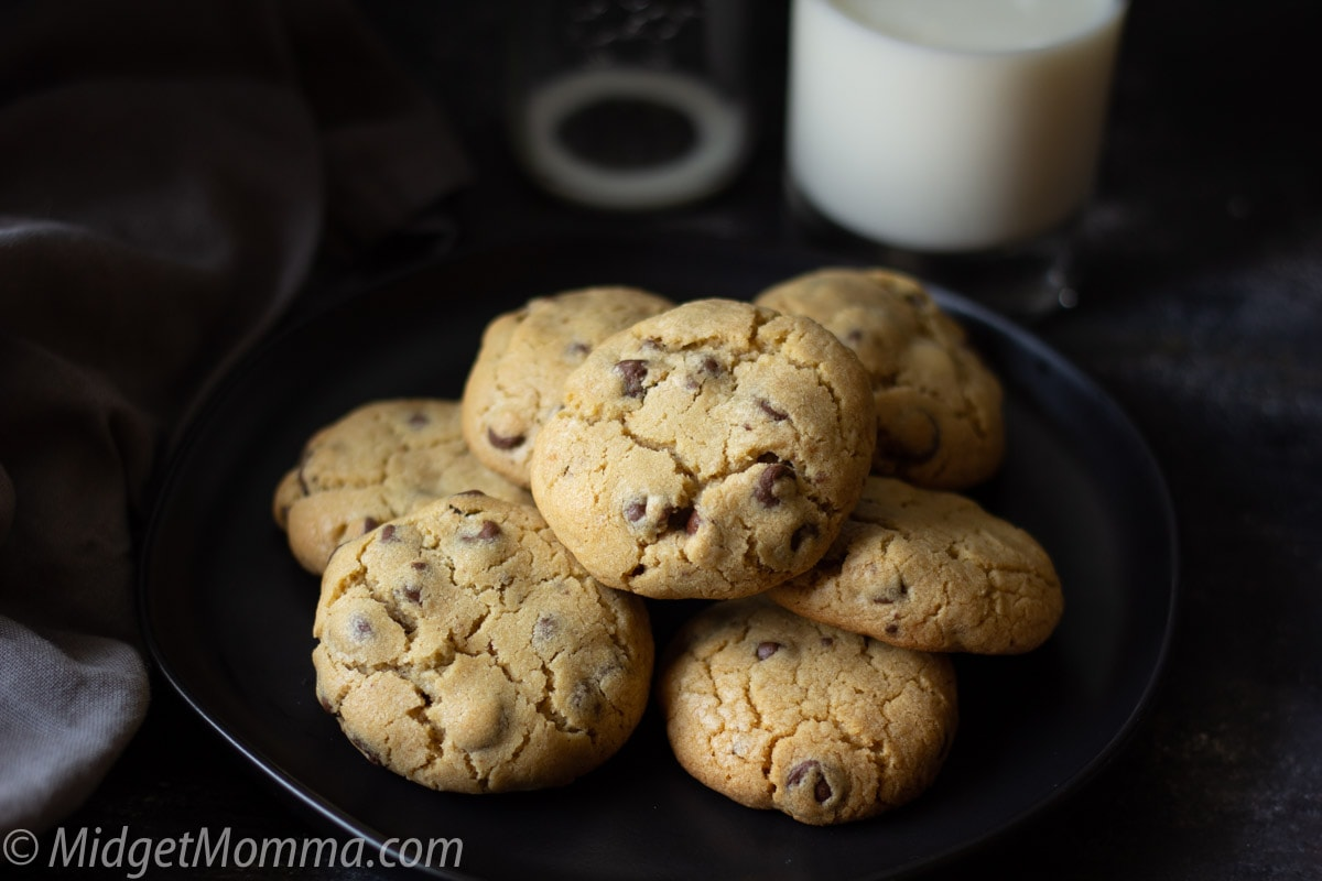 homemade chocolate chip cookies on a plate with a glass of milk
