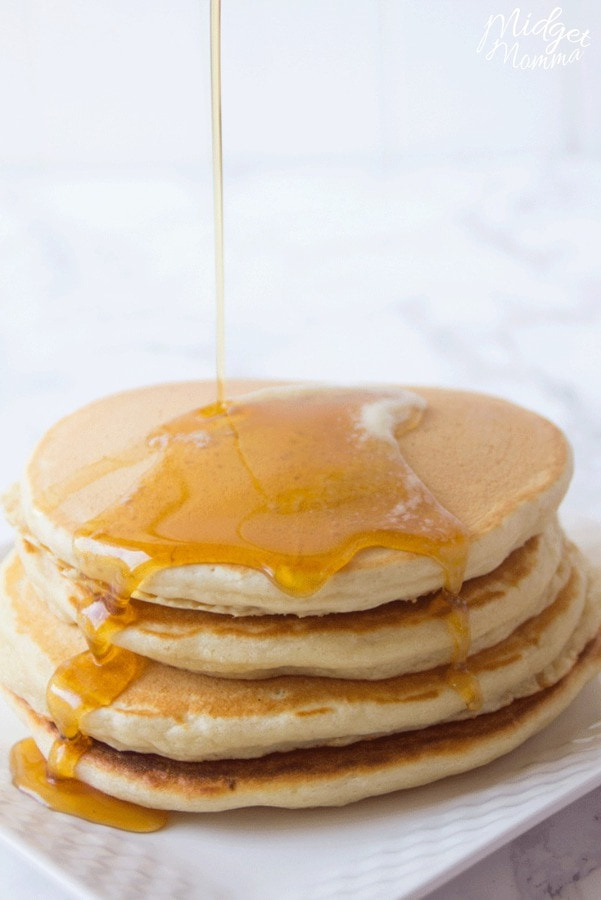 homemade pancake mix cooked in a stack of 3 homemade pancakes drizzled with maple syrup