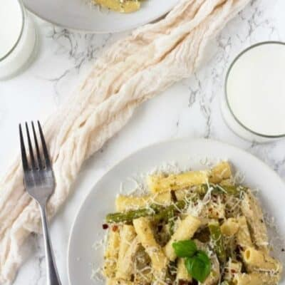 My family loves it when I make this Chicken Asparagus Alfredo Pasta. It is an easy pasta dish with ziti noodles, chicken and asparagus tossed in a creamy Alfredo Sauce!