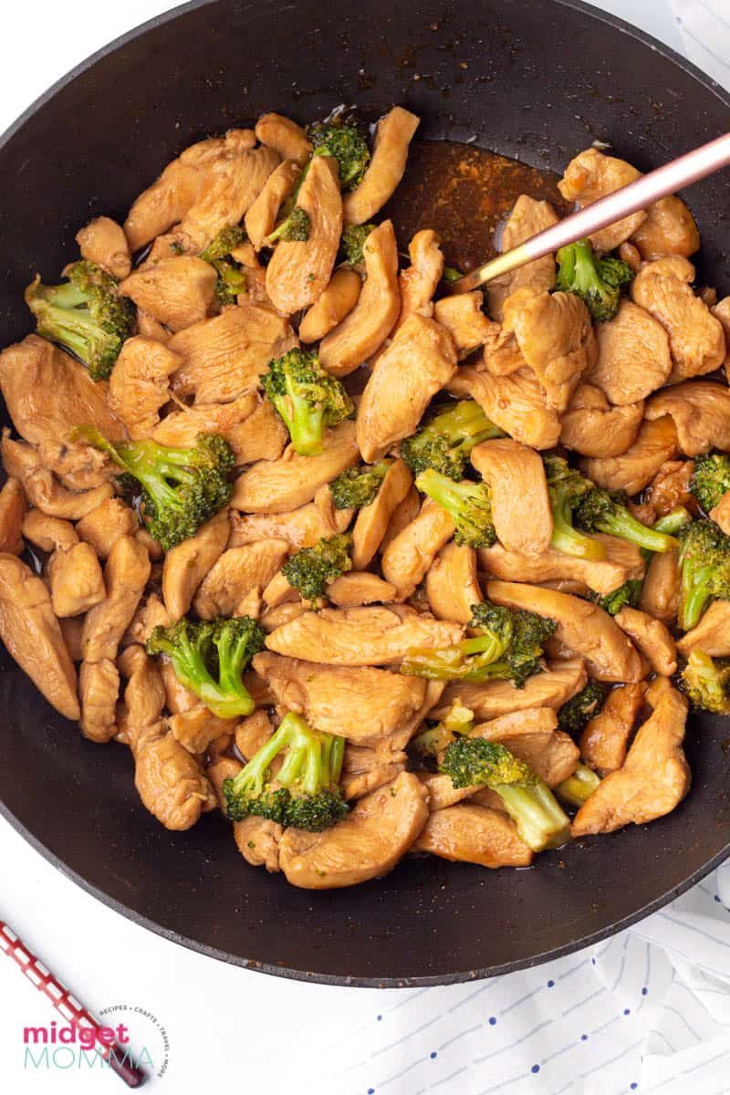 chicken and broccoli stir fry in a pan