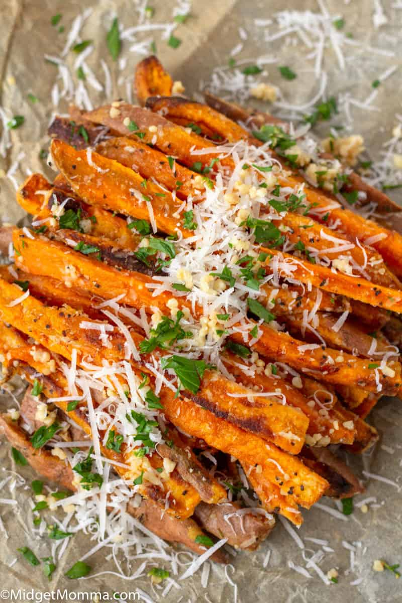 Pile of homemade sweet potatoes topped with garlic and parmesan cheese