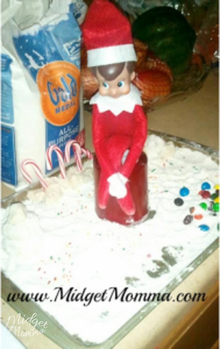 Elf on the shelf made a snow town out of flour on a baking sheet