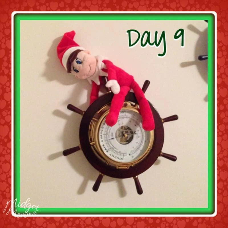 Easy Elf on the Shelf Ideas - Elf hanging from a clock on the wall