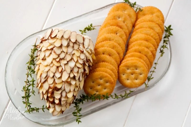 pinecone cheese ball on a tray with crackers