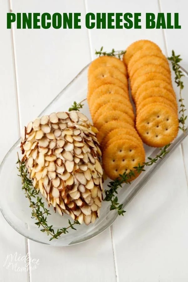 Pinecone cheeseball on a white tray with crackers
