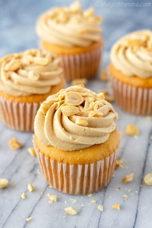 peanut butter buttercream on top of peanut butter cupcakes
