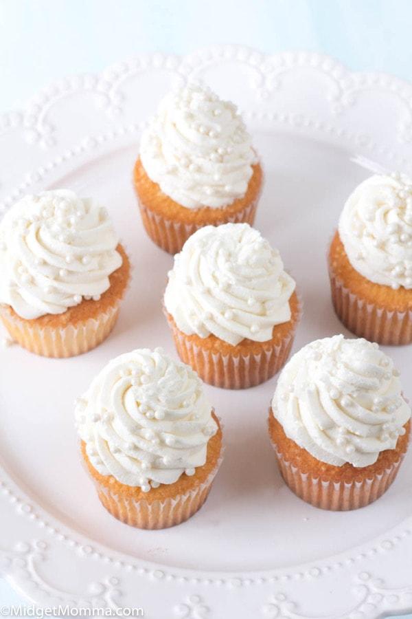 vanilla cupcakes on a white platter