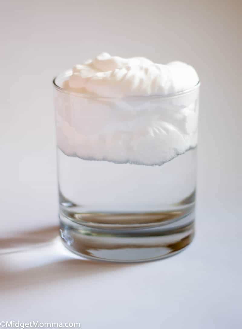 Rain Cloud science experiment glass filled with water and shaving cream