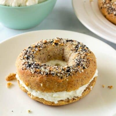 Keto bagel with cream cheese on a plate